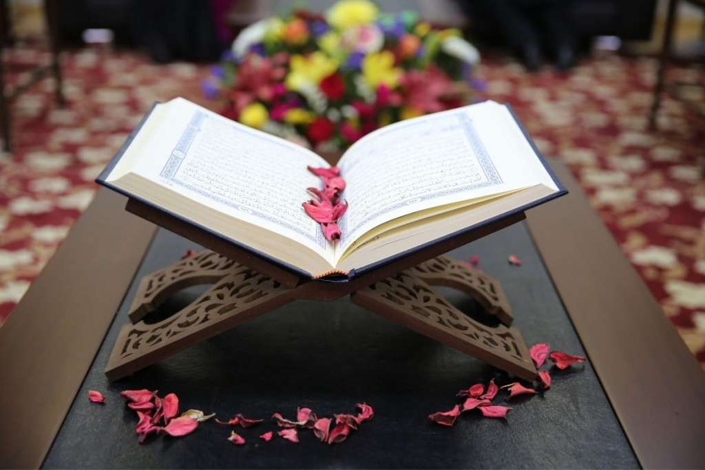 Quran with flowers to answer can you learn the Quran while on your period