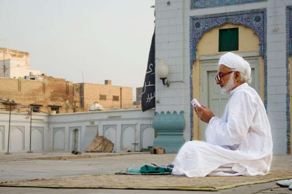 Man reading Muhaf to show the benefits of hafiz quran